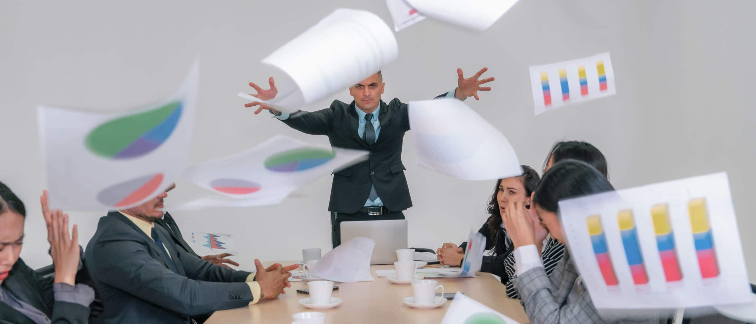 business background of angry management show anger mood by throwing paper to businesspeople in meeting room